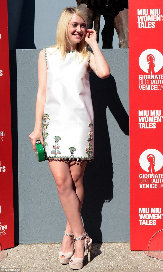 Lovely: Dakota Fanning wore the same heels at Kate Mara but teamed her pair with a white leather dress