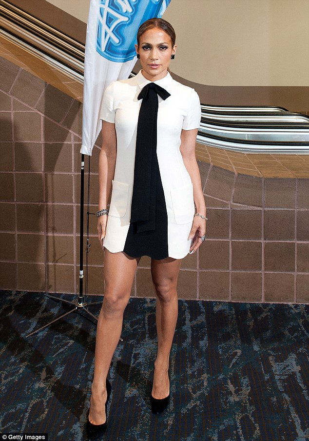 Fashion risk: Jennifer Lopez donned a masculine-inspired white frock and tie at the American Idol audition in New Orleans on Wednesday, fellow judge Keith Urban pictured alongside her