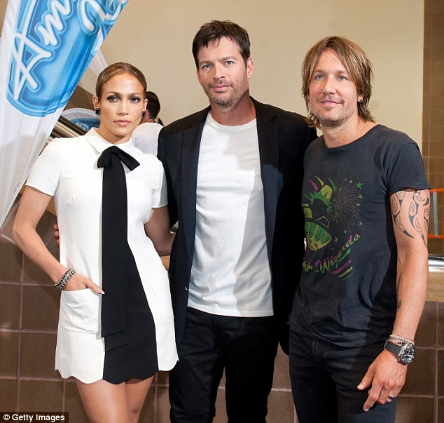 Lucky three: Jennifer posed with her fellow judges Harry Connick Jr. and Keith Urban