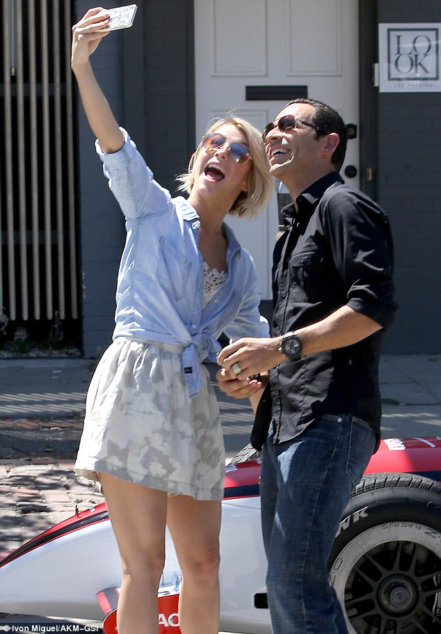 Can you say cheese: Julianne Hough took a selfie with her old pupil Helio Castroneves in Los Angeles on Wednesday