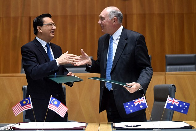 In Canberra, Deputy Prime Minister Warren Truss (pictured right) met with his Malaysian (pictured left) and Chinese counterparts and said they were cautiously optimistic the aircraft will be recovered with a one year deep sea search to begin in September