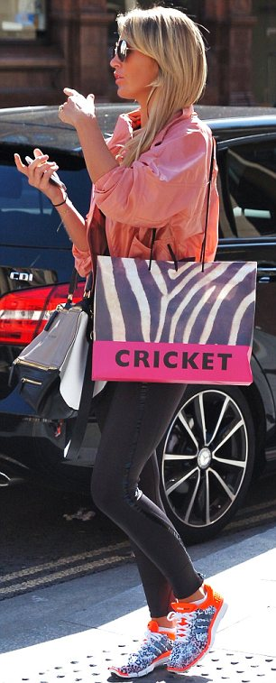 Hitting the shops: Alex did a spot of shopping at Cricket after the gym and later went for lunch