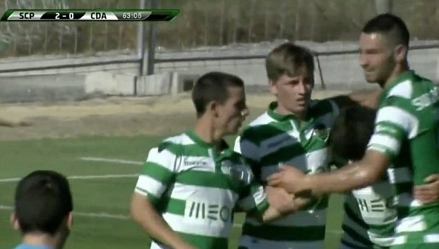 On target: Former Dundee United star Ryan Gauld celebrates with team-mates after his first Portugal goal