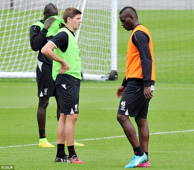 Listen up: Steven Gerrard (left) has a word with Mario Balotelli during Liverpool training this week