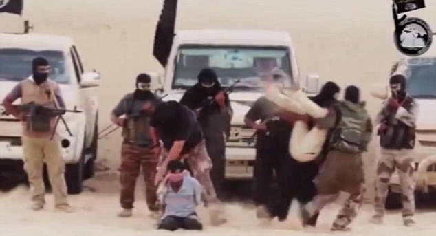 In the video, the captives can be seen kneeling on the floor with armed men in black masks standing behind them as one of the militants reads out a statement. Minutes later the four men have been beheaded
