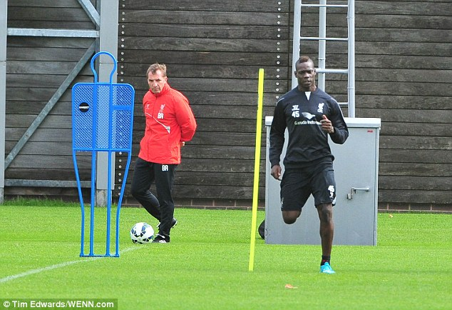 Running man: Balotelli is put through his paces during a session at Liverpool's training ground