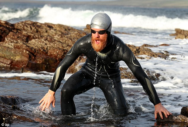 The keen photographer said he lost a stone in weight after completing the swim stage of the challenge