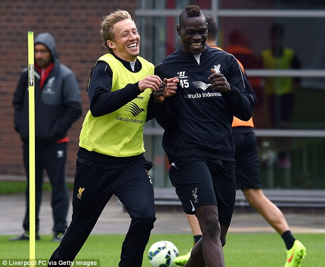 Close bond: Balotelli seems to have formed a close-knit relationship with Brazilian midfielder Lucas
