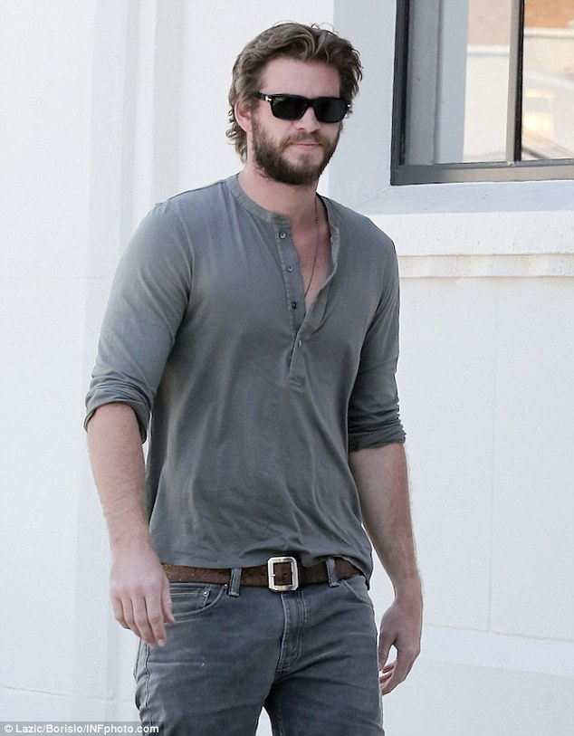 Stud: Actor Liam Hemsworth tried to go incognito in California this week, pulling off a rugged new accessory - a beard