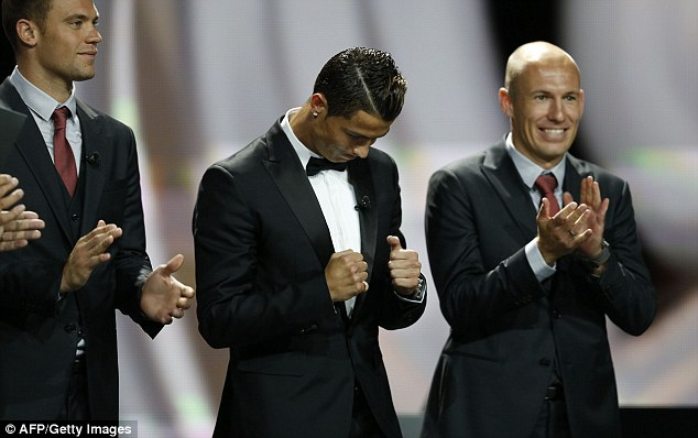 Delighted: Ronaldo celebrates after beating Bayern's Arjen Robben and Manuel Neuer to win UEFA's award