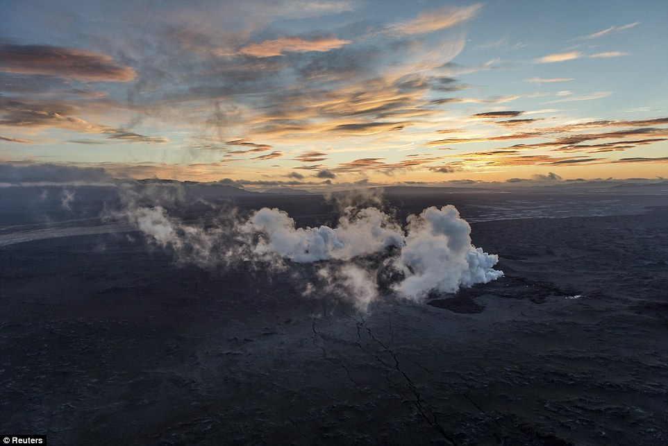 Peaceful: Steam and smoke rise over a 1km fissure in the lava field north on Bardarbunga