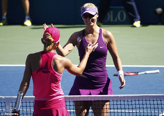 Game over: Halep and Lucic-Baroni embrace at the net following their US Open third round clash