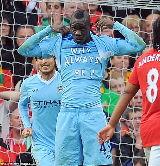 Memorable: Mario Balotelli celebrates scoring for City in the Manchester derby in 2011