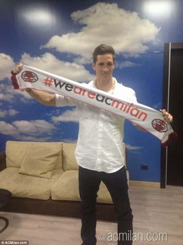 Arrival:  Torres pictured arriving in Milan on Saturday ahead of his two-year loan move from Chelsea