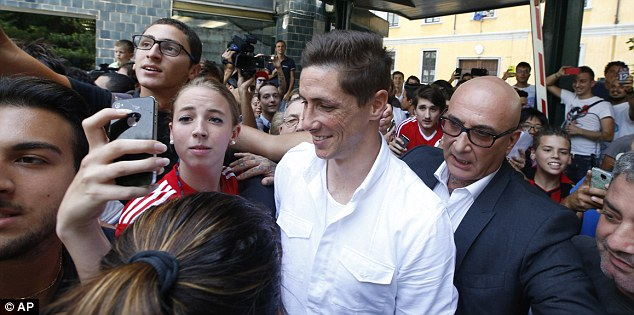 Selfie: Supporters tried to take pictures with the Spain international as he arrived for his AC Milan medical