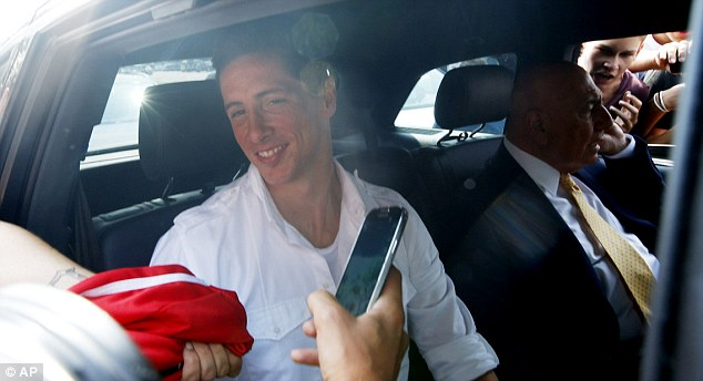En route: Torres with AC Milan CEO Adriano Galliani just after his arrival at Linate Airport on Saturday