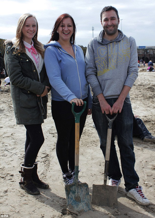 Megan and Kirsy Henderson and Kevin Wood were searching for the gold which is hidden on the beach as part of Triennial Folkestone - a public art project that takes place every three years