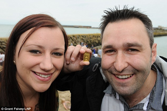It's ours, all ours - Kirsty Henderson and Kevin Wood from Canterbury are the finders of the first gold bar