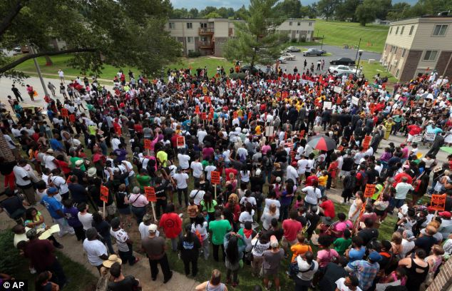 Gathering: Hundreds of people gather at the Canfield Green apartments for prayer around the memorial to Michael Brown who was killed three weeks ago