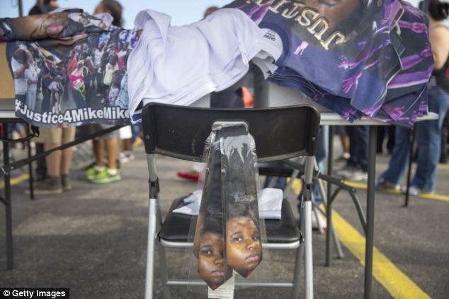 Images: Vendors sell ties with the image of Michael Brown on them along with T-shirts with #justice4Mike
