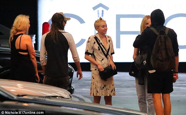 They meet again: The Wrecking Ball singer reportedly spent the evening 'laughing and flirting' with her former LOL co-star at Soho House