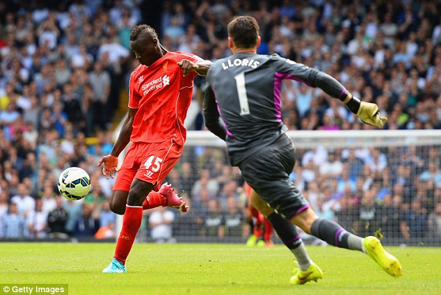 So close: Balotelli shoots at an open goal past Spurs keeper Hugo Lloris, but to no avail as the ball sails wide
