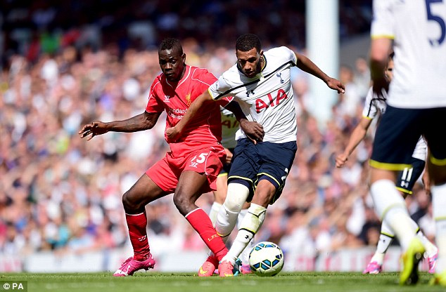 Getting stuck in: Balotelli challenges Spurs midfielder Etienne Capoue as he showed off his physicality