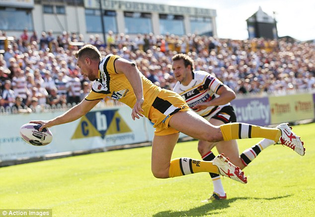 Flying high: James Clare scores Castleford's second try against Bradford to move Tigers to second