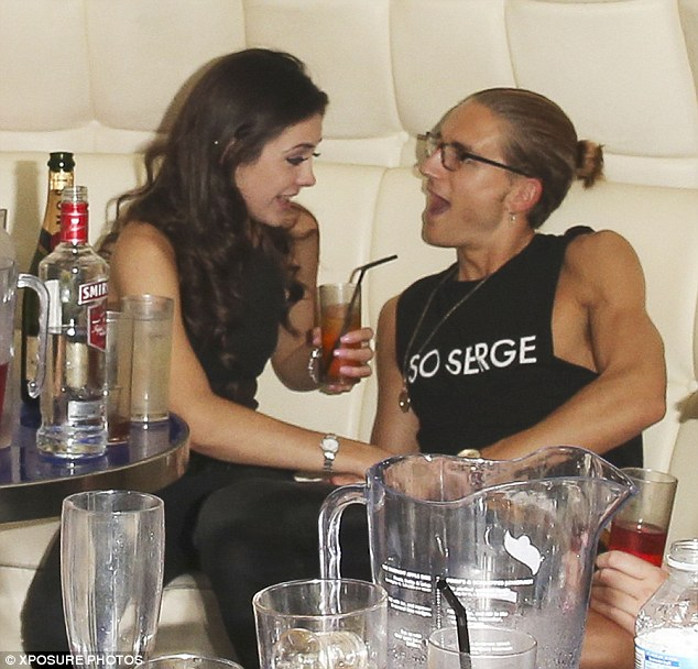 He likes that: Proudlock looks delighted as his friend places her hand on him