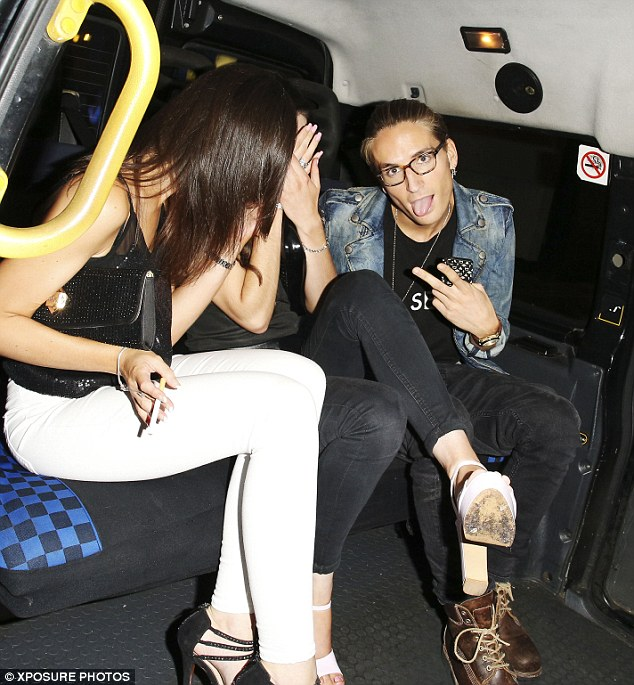 Rebel rider: Proudlock's girl appears to be holding a cigarette inside their cab, directly in front of a no smoking sign