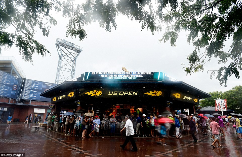 Hiding: The US Open, based in the Queens borough of New York, was flushed out at Flushing Meadows as the storms took their toll