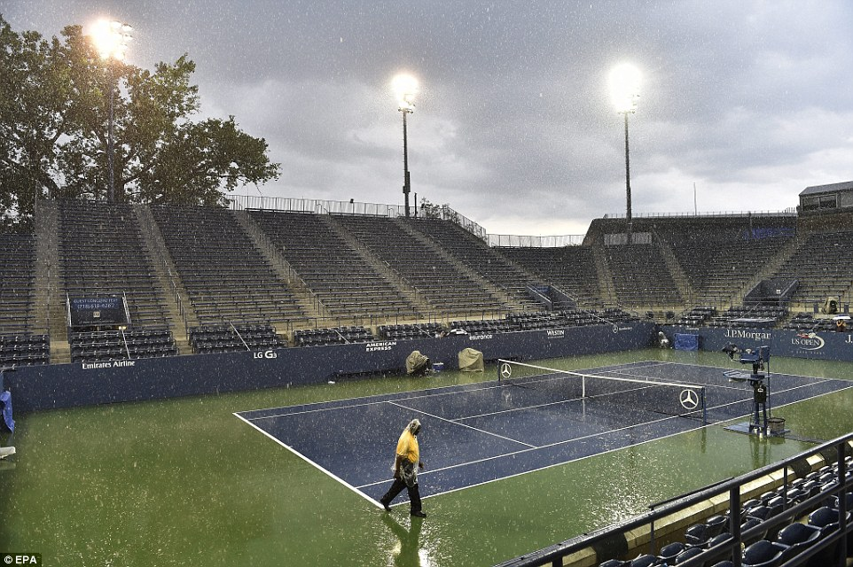 Suspended: The downpour in New York forced play to be put off at the US Open, with those there describing it as 'end-of-the-world type weather'