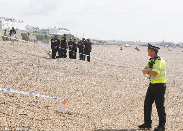 Body: Sussex Police were seen investigating at the scene of where the body was found in Brighton today