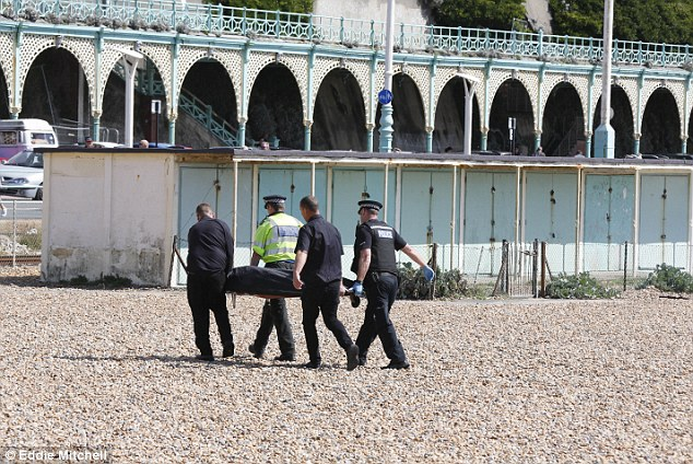 Probe: Officers are working to establish the circumstances of how the body came to be on the beach