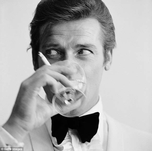 Shaken not stirred: Sir Roger Moore, who starred in seven James Bond films, drinks a martini in 1968