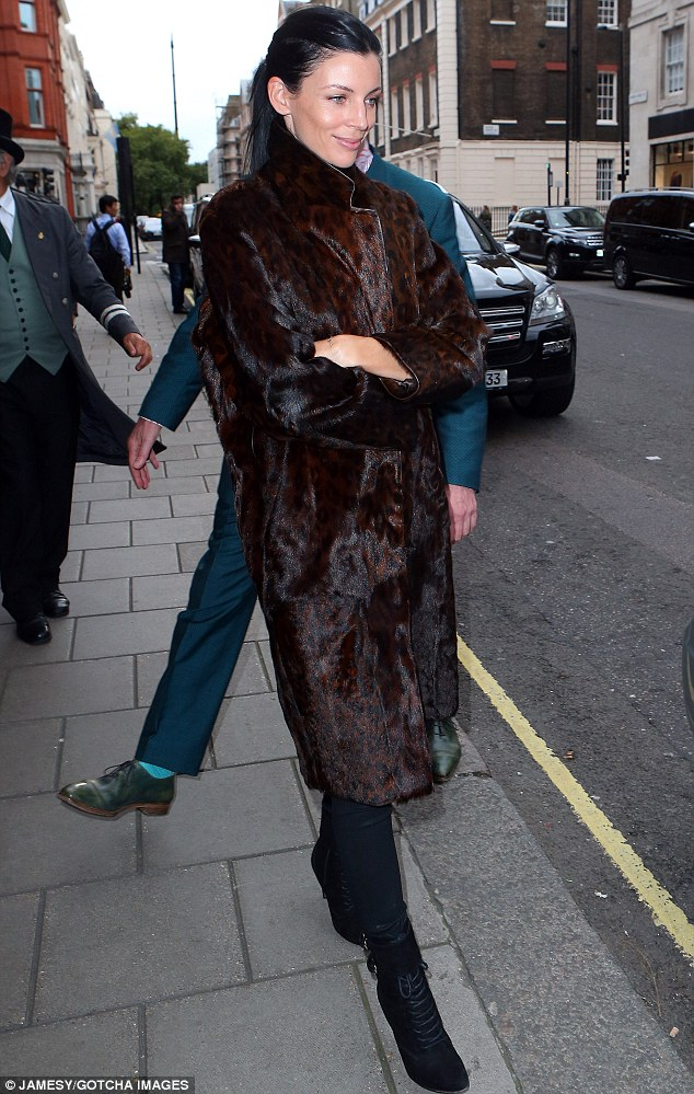 Furry nice! Liberty Ross wrapped up in a long brown coat for a night out in London on Saturday