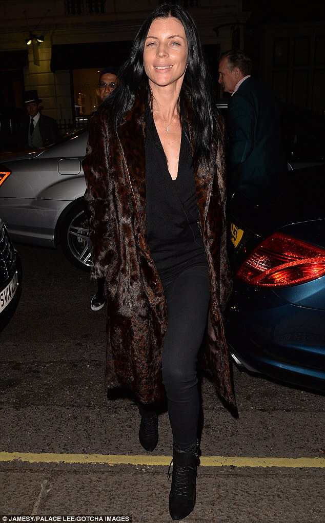 Mind the flash! The 35-year-old - who was previously married to directorRupert Sanders - finished off her ensemble with heeled boots and sleek tresses