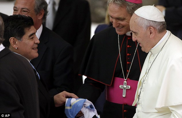 I come bearing gifts: The Argentina legend presents the pontiff with one of his national team shirts