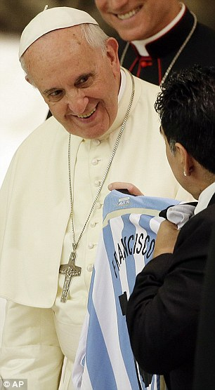 Get shirty: Diego Maradona hands the Pope a shirt with the name 'Francisco' on the back
