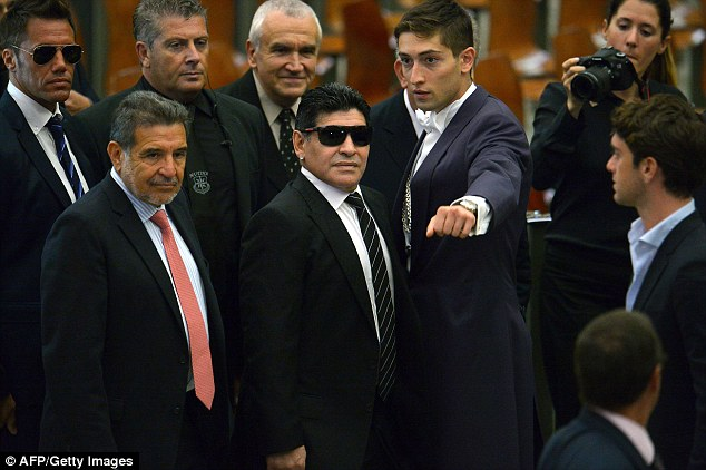 I'm here! Diego Maradona arrives at the Vatican after claiming it was an honour to be invited for the game