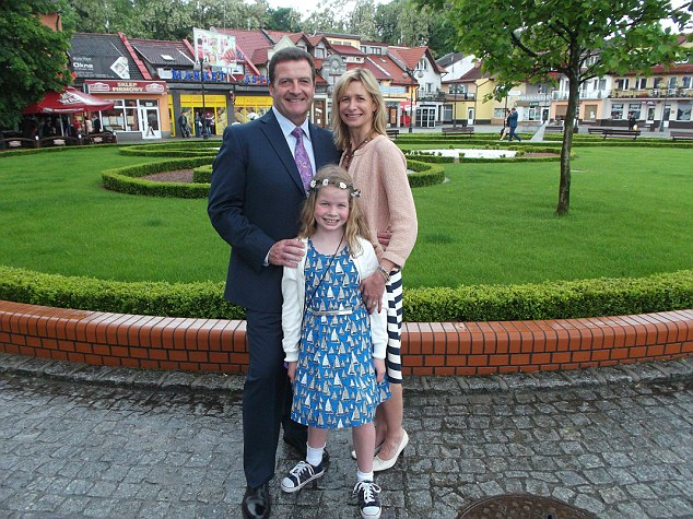 Happy guests: John visited Poland with his family to attend the wedding of an old friend