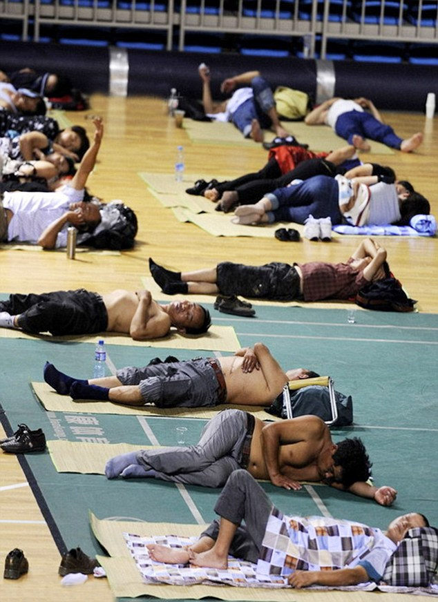 Parents of students at Shenyang Aerospace University in the city of Shenyang in north-eastern China sleep on the gym floor so that they can be near their offspring in the first few days of term