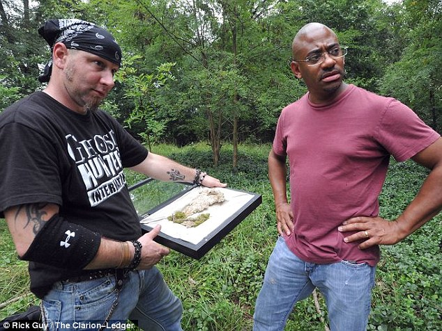 Found: Lassiter, right, contacted paranormal investigator David Childers, left, after making the discovery last month and learned that Childers had seen a mysterious gray figure in the woods last year