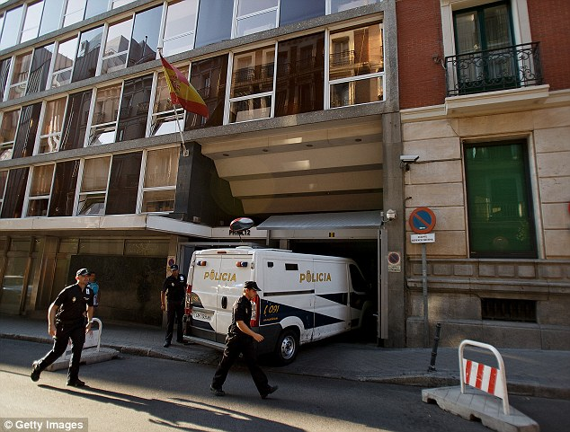 On trial: A police van holding Brett and Naghemeh King, sweeps into the National Court in Madrid, Spain this morning ahead of their hearing - they were remanded in custody for a further 72 hours