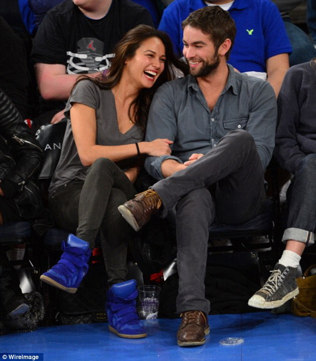 Giggles: The pair pictured here in New York City in March 2013 laughing away as they sat courtside at a basketball game