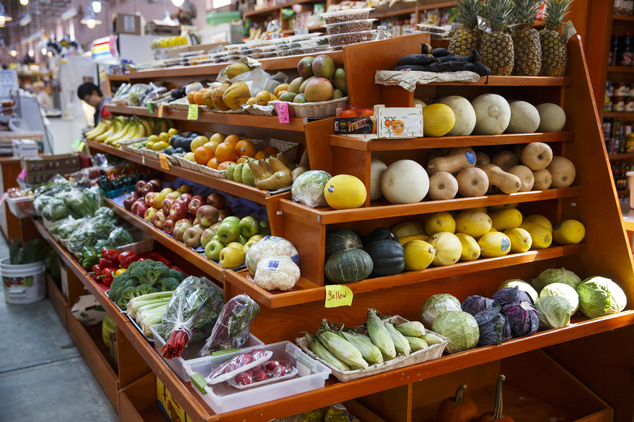 A variety of healthy fruits and vegetables are displayed for sale at a market in Washington, which adults need to consume for a healthy diet