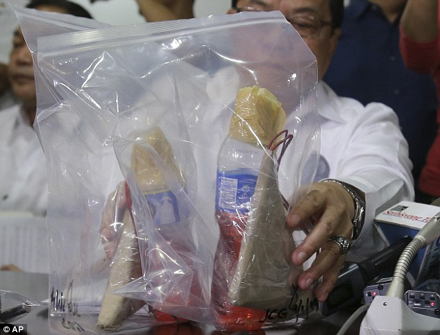 Evidence: Philippine authorities display homemade incendiary devices that were seized from the suspects