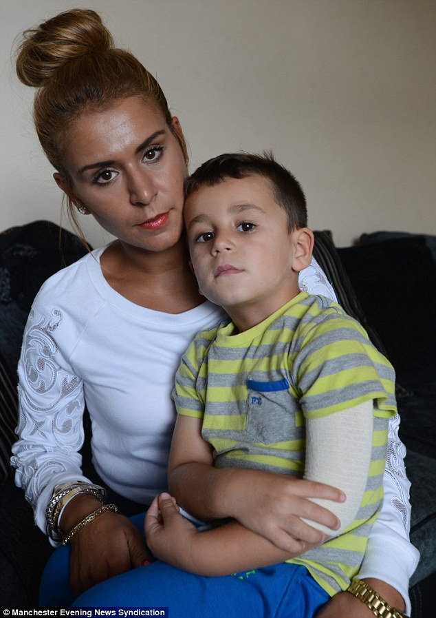Ellis Murray, three, was scarred by a henna tattoo after an allergic reaction. He is pictured here with his mother Shabana Murray, from Oldham