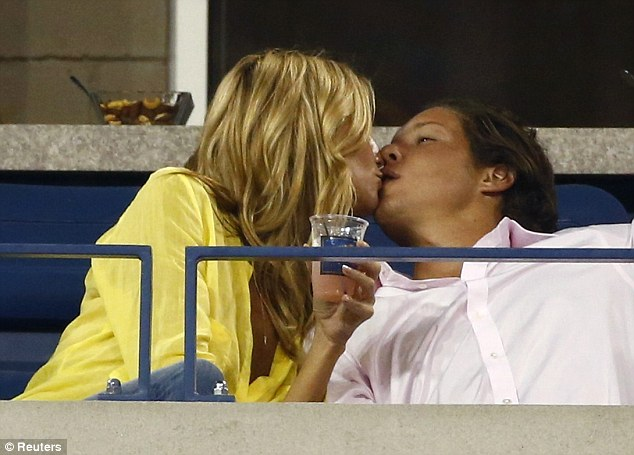 He's putty in her hands: The supermodel leaned in to kiss an obviously enamored Vito in front of everybody at the tournament