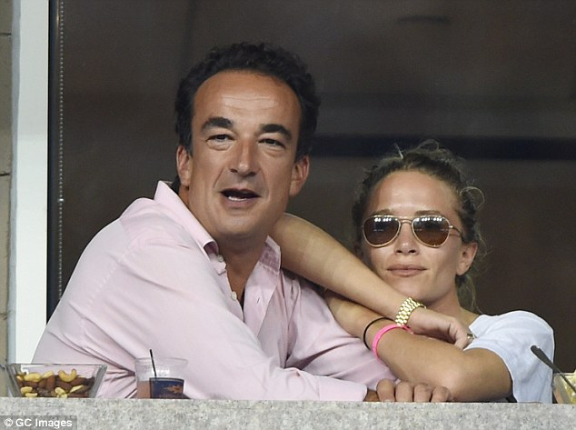 Teammates: Mary-Kate Olsen cuddled up to her fiancé Olivier Sarkozy at the tennis tournament on Monday in NY